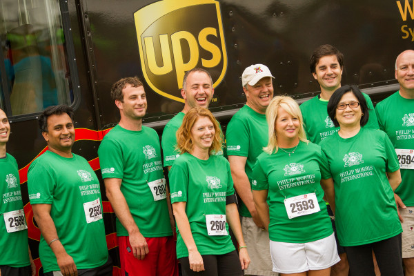 Philip Morris team pose before the Corporate Run