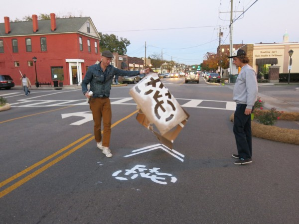 Spraying chalk sharrows